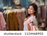 young woman with shopping bags... | Shutterstock . vector #1124468903