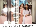 happy friends with shopping... | Shutterstock . vector #1124470193