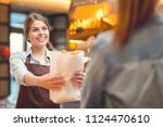 young baker and customer at the ... | Shutterstock . vector #1124470610