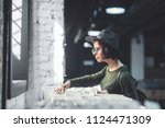 young woman in a hat in a music ... | Shutterstock . vector #1124471309