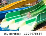 a happy toddler boy in the aqua ... | Shutterstock . vector #1124475659