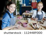 smiling girl looking at camera... | Shutterstock . vector #1124489300