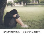 asian woman sitting alone and... | Shutterstock . vector #1124495894