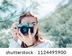 young asian woman photographer... | Shutterstock . vector #1124495900
