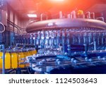 automatic filling machine pours ... | Shutterstock . vector #1124503643