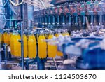 automatic filling machine pours ... | Shutterstock . vector #1124503670