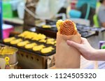 japanese taiyaki  fish shaped... | Shutterstock . vector #1124505320