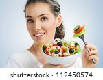 a beautiful girl eating healthy ... | Shutterstock . vector #112450574
