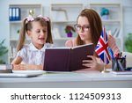 young girl learning english... | Shutterstock . vector #1124509313