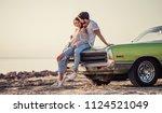 romantic couple is standing... | Shutterstock . vector #1124521049
