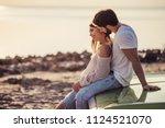 romantic couple is standing... | Shutterstock . vector #1124521070