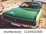 green retro car is standing on... | Shutterstock . vector #1124522300