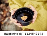 mug of hot tea in woman hand is ... | Shutterstock . vector #1124541143