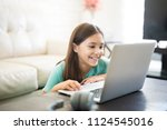 cute latin girl smiling and...   Shutterstock . vector #1124545016