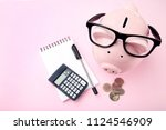 pink piggy bank with glasses ... | Shutterstock . vector #1124546909