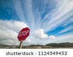 stop sign under a cloudy sky in ... | Shutterstock . vector #1124549453