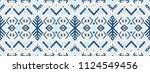 ikat geometric folklore... | Shutterstock .eps vector #1124549456