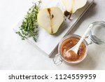 pear jam  fresh pears and thyme ... | Shutterstock . vector #1124559959