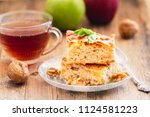 two pieces of homemade apple... | Shutterstock . vector #1124581223