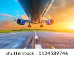 passenger airplane landing at... | Shutterstock . vector #1124589746