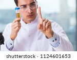 male chemist working in lab | Shutterstock . vector #1124601653