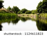 wild canal view in england.... | Shutterstock . vector #1124611823
