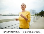 mature active blond woman in...   Shutterstock . vector #1124612408