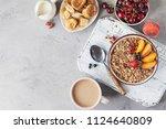healthy breakfast with granola... | Shutterstock . vector #1124640809