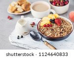 healthy breakfast with granola... | Shutterstock . vector #1124640833
