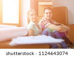 couple moving in house sitting... | Shutterstock . vector #1124643074