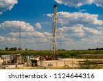 oil and gas facilities | Shutterstock . vector #1124644316