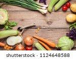 different raw vegetables over... | Shutterstock . vector #1124648588