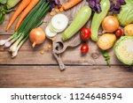different raw vegetables over... | Shutterstock . vector #1124648594