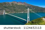the hardanger bridge is a... | Shutterstock . vector #1124652113
