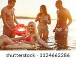smiling young woman in a bikini ... | Shutterstock . vector #1124662286