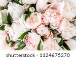 bouquet of a lot of peonies of...   Shutterstock . vector #1124675270