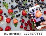 photographing food. hands... | Shutterstock . vector #1124677568