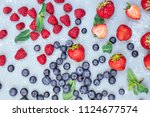 mix of fresh juicy berries on... | Shutterstock . vector #1124677574