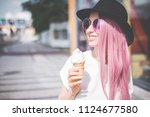happy young hipster woman with... | Shutterstock . vector #1124677580