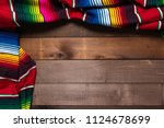 a mexican serape blanket on a... | Shutterstock . vector #1124678699