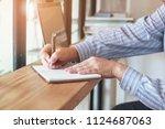 working at shop. business man... | Shutterstock . vector #1124687063
