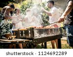 friends making barbecue in the... | Shutterstock . vector #1124692289