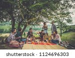 group of friends spending time... | Shutterstock . vector #1124696303