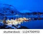 boats after sunset in lofoten... | Shutterstock . vector #1124700953