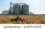 agricultural silos   building... | Shutterstock . vector #1124712299