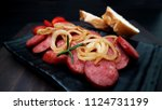 smoked sausage with bread and... | Shutterstock . vector #1124731199