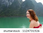 young woman traveling by boat... | Shutterstock . vector #1124731526