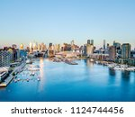 an aerial view of the docklands ... | Shutterstock . vector #1124744456