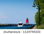lighthouse in charlevoix on... | Shutterstock . vector #1124745233