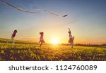 happy family playing outdoor.... | Shutterstock . vector #1124760089